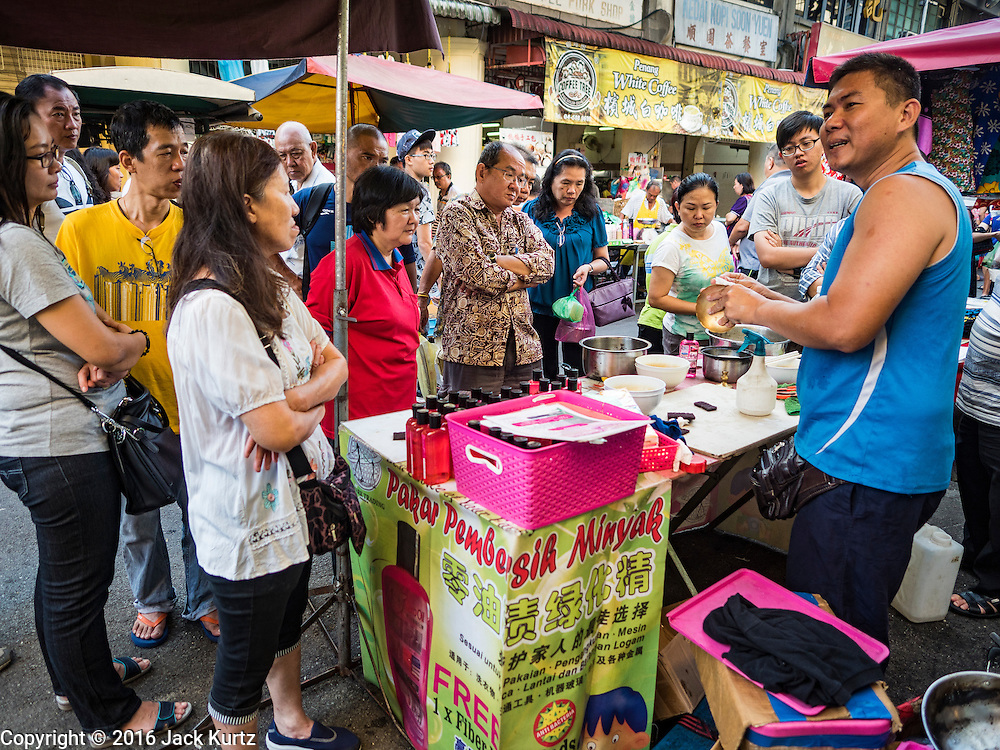 17 NOVEMBER 2016 - GEORGE TOWN, PENANG, MALAYSIA: A hawker sells home cleaning supplies in a market in George Town, Penang, Malaysia. George Town is a UNESCO World Heritage city and wrestles with maintaining its traditional lifestyle and mass tourism.       PHOTO BY JACK KURTZ