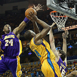 April 22, 2011; New Orleans, LA, USA; Los Angeles Lakers shooting guard Kobe Bryant (24) blocks a shot by New Orleans Hornets power forward Carl Landry (24) during the first quarter in game three of the first round of the 2011 NBA playoffs at the New Orleans Arena.    Mandatory Credit: Derick E. Hingle
