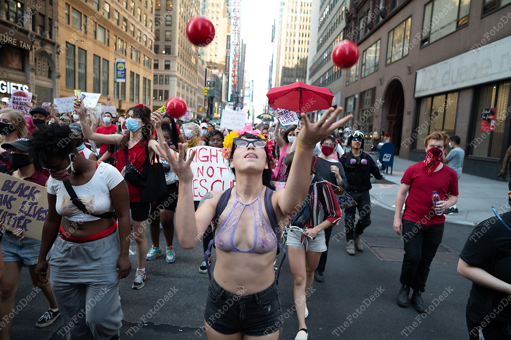 Demonstrators are shown during a Black Sex Worker Liberation March and Vigil in Times Square in New York, New York.  Demonstrators march to and around Madison Square Garden and back to Time Square.<br />  ©Brian Branch-Price