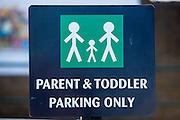 A parent & toddler parking sign in a supermarket car park, London.