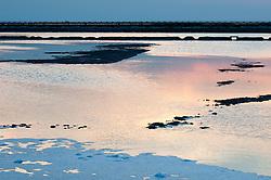 Il complesso produttivo delle saline è situato nel comune italiano di Margherita di Savoia (nome dato dagli abitanti in onore alla regina d'Italia che molto si adoperò nei confronti dei salinieri) nella provincia di Barletta-Andria-Trani in Puglia. Sono le più grandi d'Europa e le seconde nel mondo, in grado di produrre circa la metà del sale marino nazionale (500.000 di tonnellate annue).All'interno dei suoi bacini si sono insediate popolazioni di uccelli migratori e non, divenuti stanziali quali il fenicottero rosa, airone cenerino, garzetta, avocetta, cavaliere d'Italia, chiurlo, chiurlotello, fischione, volpoca..Tramonto sui bacini di raccolta ed evaporazione delle acque del mare per la produzione di sale.