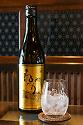 Bottle and glass of shochu, Nekka Shochu Distillery, Tadami, Fukushima, Japan, February 22, 2018. The Nekka shochu distillery was founded in July 2016 and at that time was the smallest shochu distillery in Japan. It makes shochu from locally-grown rice, and is helping support a local economy that has languished since the nuclear disaster of 2011.