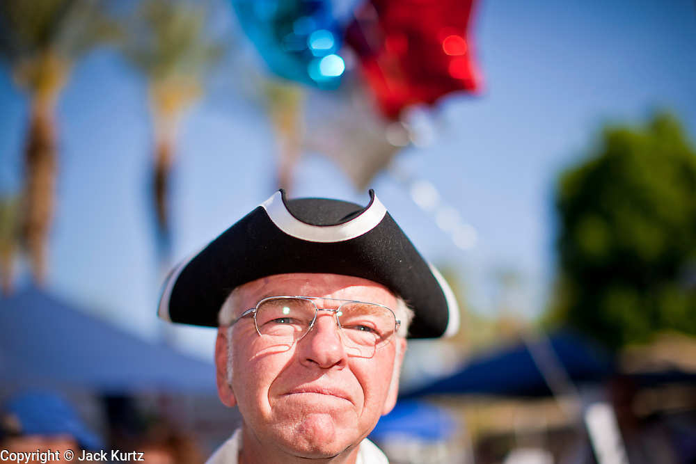 15 APRIL 2011 - PHOENIX, AZ: PATRICK LACEY, a supporter of the Tea Party, wears a tri-corner hat at a Tea Party rally in Phoenix, AZ, Friday. About 500 supporters of the Tea Party movement rallied Friday at the Arizona State Capitol to mark tax day. They protested high taxes, the federal deficit, the debt limit and immigration policy. About 50 pro-immigrant protesters held a counter rally at the capitol. At least one person was arrested, and others led away by police after several shouting matches between Tea Party supporters and the immigrants rights protesters broke out.     Photo by Jack Kurtz
