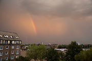 Double rainbow in the sky above a housing development in Wapping, London, UK.