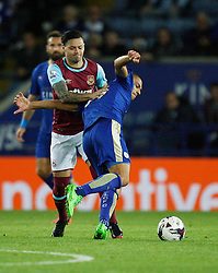 Mauro Zarate of West Ham United (L) fouls Gokhan Inler of Leicester City  - Mandatory byline: Jack Phillips/JMP - 07966386802 - 22/09/2015 - SPORT - FOOTBALL - Leicester - King Power Stadium - Leicester City v West Ham United - Capital One Cup Round 3