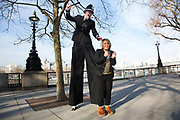 Tommy West, street performer on the walkway dressed as a stilt walking 10 foot high policeman. He jokes with tourists offering them a perfect photo opportunity as they pose as cops and robbers, in handcuffs and mock criminal situations. The South Bank is a significant arts and entertainment district, and home to an endless list of activities for Londoners, visitors and tourists alike.