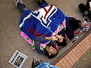 obamatucson 12 JANUARY 2011 - TUCSON, AZ: Alex Velasquez (CQ), right foreground, Kristi Campuzano (CQ) CENTER and Francine Figueroa (CQ) rest under a blanket in the line to get tickets to see President Obama at McKale Center. The line to see President Obama speak at Wednesday night's service in the McKale Center at the University of Arizona started forming at 18:30 Tuesday night and continued to grow overnight. By 6:30 Wednesday morning at 100 people were in line. The service is for the victims of Saturday's mass shooting at a Safeway in Tucson.    ARIZONA REPUBLIC PHOTO BY JACK KURTZ..Gabrielle Giffords shooting, mass shooting,