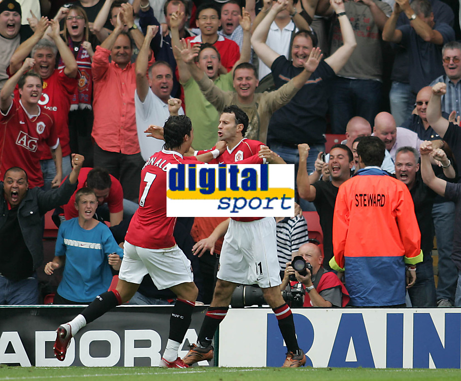 Photo: Lee Earle.<br /> Watford v Manchester United. The Barclays Premiership. 26/08/2006. United's Cristiano Ronaldo (L) congratulates Ryan Giggs after he scored their second.