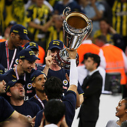 Fenerbahce's players celebrate with the BEKO Basketball League Champions Cup trophy during their Turkish Basketball league Play Off Final Sixth Leg match Fenerbahce Ulker between Efes Pilsen at the Abdi Ipekci Arena in Istanbul Turkey on Wednesday 02 June 2010. Photo by Aykut AKICI/TURKPIX