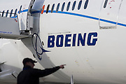 Boeing employee and company 787 Dreamliner (N787BX) at the Farnborough Airshow. On its first flight outside of the US during its testing programme, the newest airliner in the Boeing aviation family, has arrived at the air show for a few days of exhibitions to the aerospace-buying community and the trade press. Later the public will have the chance to see this jet up close too. The Boeing 787 Dreamliner is a long range, mid-sized, wide-body, twin-engine  jet airliner developed by Boeing Commercial Airplanes. It seats 210 to 330 passengers, depending on variant. Boeing states that it is the company's most fuel-efficient airliner and the world's first major airliner to use composite materials for most of its construction