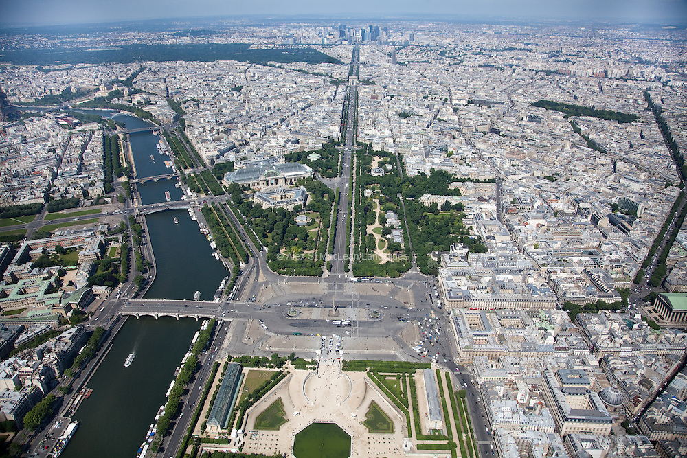 Looking down the Tuileries Gardens and the Champs-Elysees towards the Arc du Triomphe and La Defense with the Nef du Grand Palais and The Petit Palais on the left.