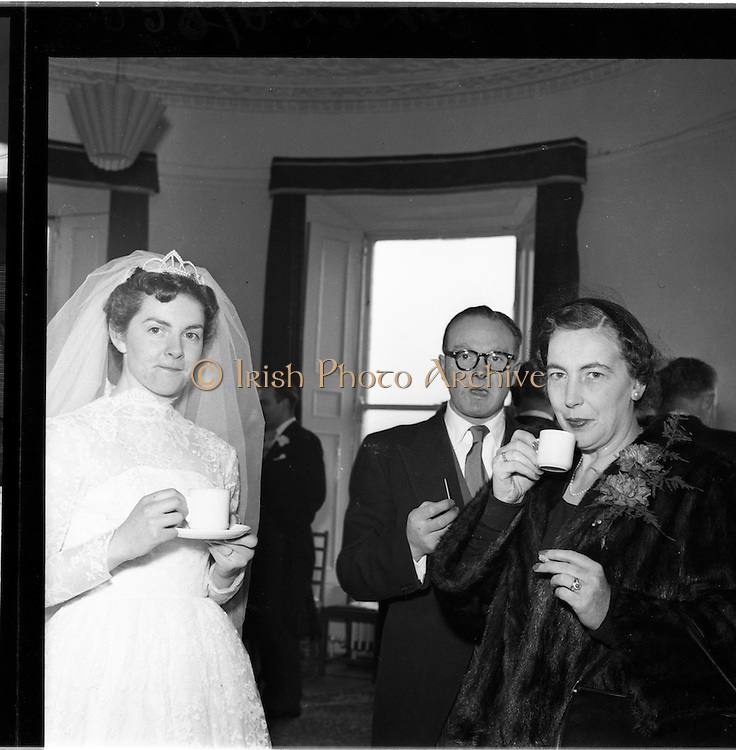 18/02/1957<br /> 02/18/1957<br /> 18 February 1957<br /> Wedding Dr K. Murphy and J. Fitzgerald at St. Mary's Church, Haddington Road and reception at Salthill Hotel, Monkstown. Bride at the reception with cup of tea.