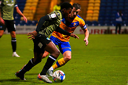 Ollie Clarke of Mansfield Town runs down Kwame Poku of Colchester United - Mandatory by-line: Ryan Crockett/JMP - 20/11/2020 - FOOTBALL - One Call Stadium - Mansfield, England - Mansfield Town v Colchester United - Sky Bet League Two