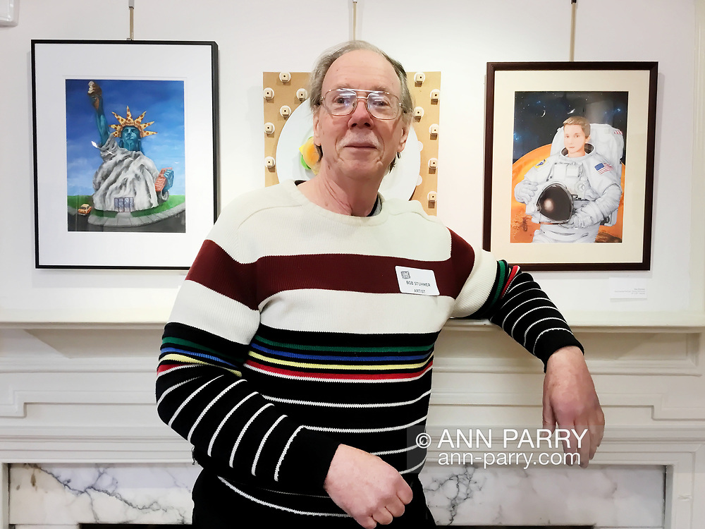 Manhasset, New York, U.S. April 7, 2017. BOB STUHMER stands between his personalized pencil illustration of a boy astronaut and another artist's work at Reception for The Art Guild exhibition is held at Elderfields Preserve.