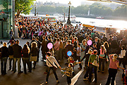 Crowds walking along the embankment during the Thames Festival 08, along the southbank of the Thames. September 2008
