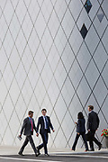 Businesspeople with geometric angles and diagonal lines on new architecture at Southwark SE1, on 7th September 2018, in London, England.