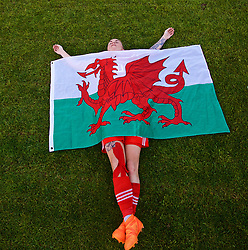 NEWPORT, WALES - Tuesday, June 12, 2018: Wales' Jessica Fishlock is draped in a Welsh flag by a team-mate as she celebrates at the final whistle after beating Russia 3-0 during the FIFA Women's World Cup 2019 Qualifying Round Group 1 match between Wales and Russia at Newport Stadium. (Pic by David Rawcliffe/Propaganda)