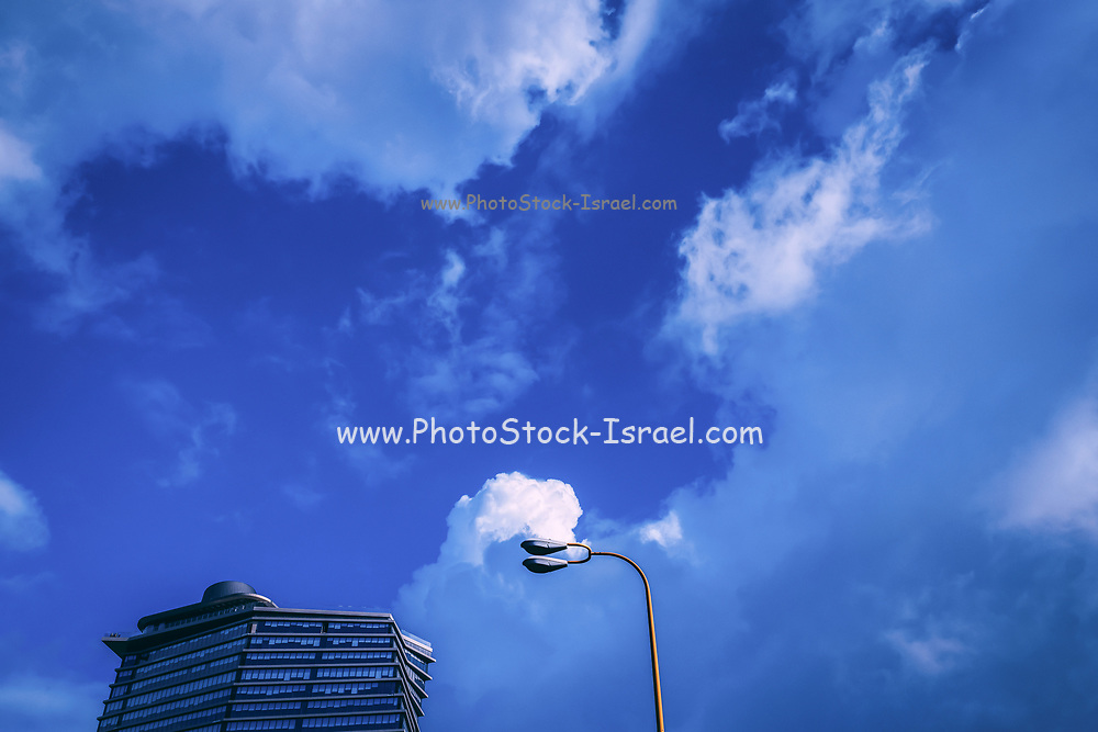 Modern high-rise architecture with a partially cloudy sky
