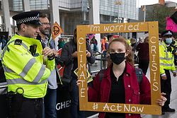 Environmental activists from Extinction Rebellion assemble outside London Bridge station on the ninth day of their Impossible Rebellion protests on 31st August 2021 in London, United Kingdom. Extinction Rebellion are calling on the UK government to cease all new fossil fuel investment with immediate effect.