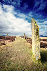 Standing stones in the Ring 'O Brodgar, Stenness, Orkney.  Part of the Heart of Neolithic Orkney World Heritage Site, the Ring o' Brodgar is found in the West Mainland parish of Stenness. It stands on an eastward-sloping plateau on the Ness o' Brodgar - a thin strip of land separating the Harray and Stenness lochs. With a diameter of 103.6 metres (340 ft), the Brodgar ring is the third largest stone circle in the British Isles.<br /> <br /> (c) Andrew Wilson | Edinburgh Elite media