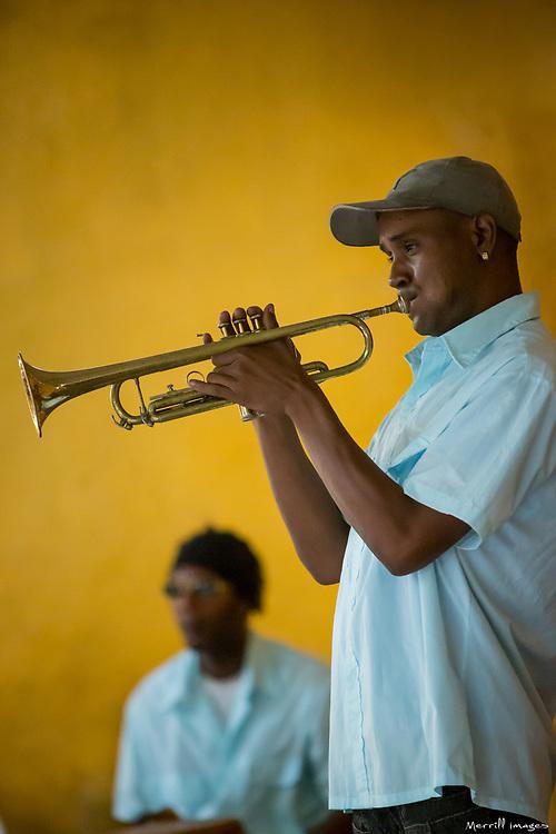 Caribbean, Cuba, Trinidad, trumpet player and drummer in restaurant, UNESCO World Heritage Site