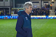 West Ham United manager Manuel Pellegrini walking on pitch during the The FA Cup match between AFC Wimbledon and West Ham United at the Cherry Red Records Stadium, Kingston, England on 26 January 2019.