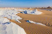 Wind sculpted chalk waves and sand in the Sahara Beida (White Desert) near Farafra, Egypt