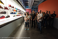 Checking out the display of gas tanks on a tour of the Harley-Davidson Museum during the Milwaukee Rally. Milwaukee, WI, USA. Saturday, September 3, 2016. Photography ©2016 Michael Lichter.