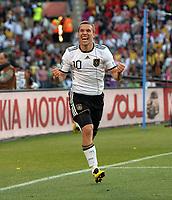 Lukas Padolski Celebrates Scoring 2nd Goal<br /> Germany World Cup 2010<br /> Germany V England 27/06/10 Round Of 16<br /> FIFA World Cup 2010<br /> Photo Robin Parker Fotosports International