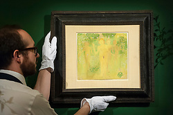 """© Licensed to London News Pictures. 01/06/2018. LONDON, UK. A Sotheby's technician presents """"The Secret of Temptation with Portrait of Ivan Kliun on the verso"""", 1908, by Kazimir Severinovich Malevich (Est. GBP250-350k) at a preview of the Russian Pictures and Russian Works of Art, Fabergé & Icons sale which will take place at Sotheby's, New Bond Street on 5 June.  Photo credit: Stephen Chung/LNP"""