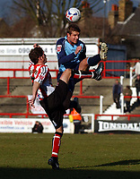 Photo: Olly Greenwood.<br />Brentford v Barnsley. Coca Cola League 1. 11/03/2006. Brentford's Alex Rhodes (L) and Barnsley's Stephen McPhail battle.