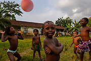 """Children playing soccer in a old """"roça"""" (old cocoa farm) in Príncipe island."""