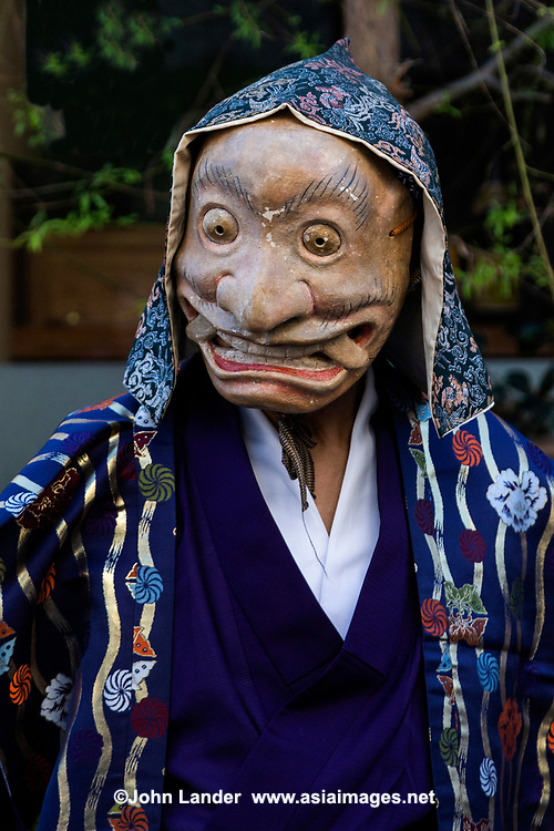 Oni Demon at Mengake Procession Kamakura- Mengake or Masked Parade at Goryo Jinja shrine.  At this festival held in September a group of ten people take part in this annual ritual: 8 men and 2 women. Wearing comical or grotesque masks that signify different demons, legends and dieties  leave the shrine and parade through the nearby streets accompanied by portable shrine and festival music.