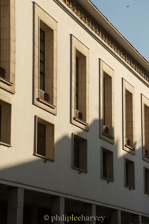 Partly shadowed architectural detail with windows in Casablanca, Morocco