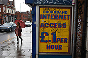 Sign offering broadband internet access for £1 per hour on a wall in Balsall Heath, Birmingham, United Kingdom.