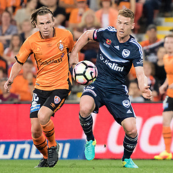BRISBANE, AUSTRALIA - OCTOBER 7: Brett Holman of the Roar and Oliver Bozanic of the Victory compete for the ball during the round 1 Hyundai A-League match between the Brisbane Roar and Melbourne Victory at Suncorp Stadium on October 7, 2016 in Brisbane, Australia. (Photo by Patrick Kearney/Brisbane Roar)