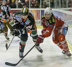 24.02.2013, Stadthalle, Klagenfurt, AUT, EBEL, EC KAC vs Graz 99ers, playoff best of seven 1. Runde im Bild Kristoph Reinthaler (Graz 99ers, #24), Thomas Hundertpfund (Kac, #27) // during the Erste Bank Icehockey League playoff best of seven 1st round between EC KAC and Graz 99ers at the City Hall, Klagenfurt, Austria on 2013/02/24. EXPA Pictures © 2013, PhotoCredit: EXPA/ Mag. Gert Steinthaler