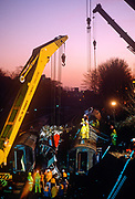 Cranes and lifting equipment raise wreckage from a train carriage after the Clapham rail disaster at Wandsworth, on 12th December 1988, in London, England. (Photo by Richard Baker / In Pictures via Getty Images)