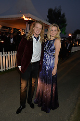 AMBER ATHERTON and FREDRIK FERRIER at the Chovgan Twilight Polo Gala in association with the PNN Group held at Ham Polo Club, Petersham Close, Richmond, Surrey on 10th September 2014.