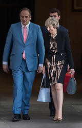 © Licensed to London News Pictures. 05/07/2016. London, UK. Home Secretary Theresa May smiles as she leaves Parliament after winning  tonight's first round of voting in the Conservative Party leadership race. Photo credit: Peter Macdiarmid/LNP