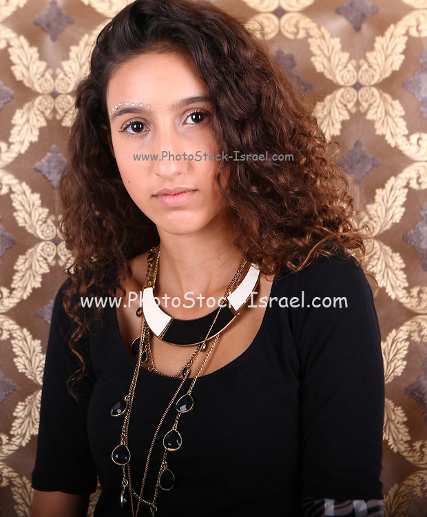 portrait of a young fashionable female teen in black top
