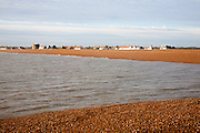 The coastal hamlet of Shingle Street seen from the sea, Suffolk, England