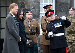 Prince Harry and Meghan Markle meet Sgt David Beveridge (right) before he fires the One o'clock gun at Edinburgh Castle, during their visit to Scotland.