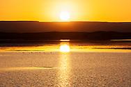 Sunrise over a rain-filled lake at the Erg Chebbi sand dunes in Merzouga, Morocco.