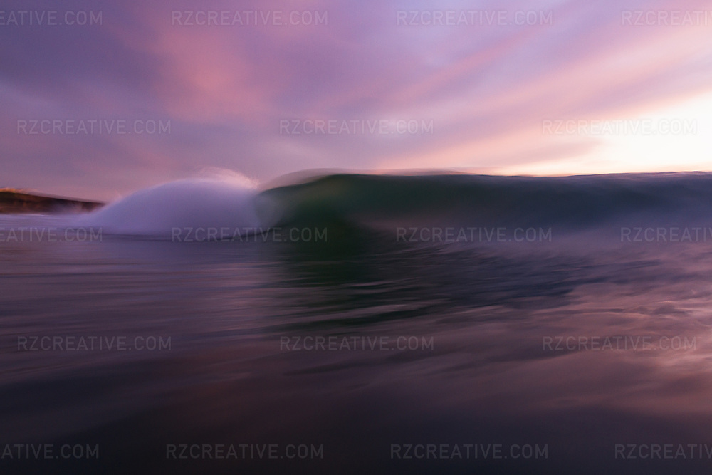 Water shot of a breaking wave at sunset. Photo © Robert Zaleski / rzcreative.com<br /> —<br /> To license this image contact: robert@rzcreative.com