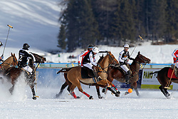 Thomas Wolfenberger of team Germany going for the ball<br /> St.Moritz Polo World Cup On Snow 2011<br /> © Dirk Caremans