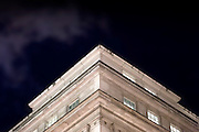 Corner of office building roof in portman square, london, at night