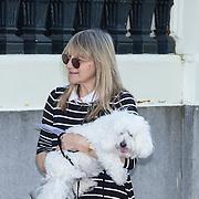 NLD/Amsterdam/20130607 - Barbra Streisand assistant laat haar hond uit - Barbra Streisand's assistant with Barbra's dog