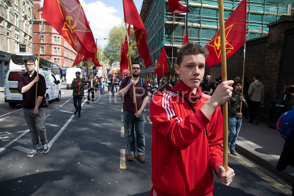 Communist Party of Great Britain during May Day celebrations in London, England, United Kingdom. Demonstration by unions and other organisations of workers to mark the annual May Day or Labour Day. Groups from all nationalities from around the World, living in London gathered to march to a rally in central London to mark the global workers day.