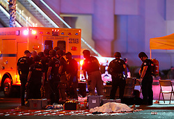 Oct 1, 2017 - Las Vegas, Nevada, U.S. - A body is covered with a sheet in the intersection of Tropicana Avenue and Las Vegas Boulevard South after a mass shooting at a music festival on the Las Vegas Strip Sunday, Oct. 1, 2017. At least 58 people died in the shooting and 515 people were injured Sunday night. The shooting has become the deadliest in modern U.S. history. The suspect, 64-year-old Stephen Paddock, was found dead in his Mandalay Bay hotel room. (Credit Image: © Steve Marcus/Las Vegas Sun via ZUMA Wire)